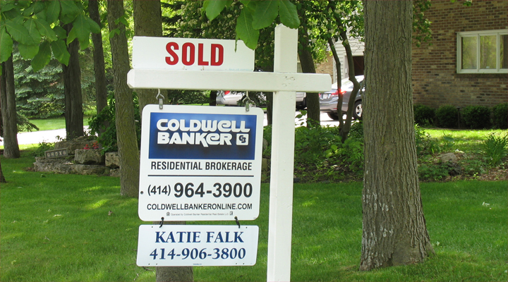 A Coldwell Banker sign that says sold on it