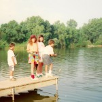 Kids fishing off the Lac du Cours dock during the Fishing Derby 1991