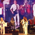 Band members from Arrival From Sweden performing ABBA