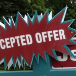 Close up of the accepted offer sign from Exit Realty XL