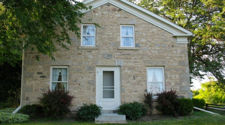 View of Jonathan Clark House front facade with fieldstone and limestone wall