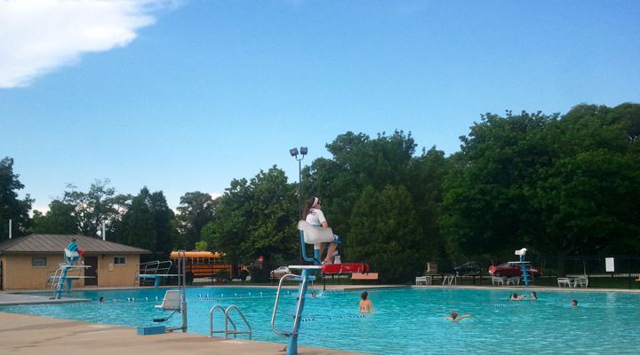 Mequon pool with lifeguard on tower watching swimmers